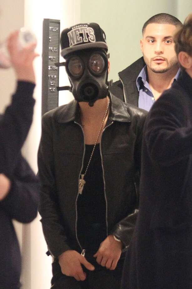 Justin Bieber wears disturbing things on his face. Photo: Neil Mockford, FilmMagic