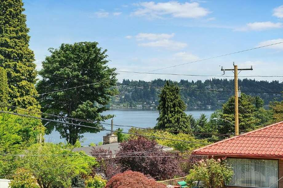 View from 4007 Cascadia Ave. S. The 1,980-square-foot house, built in 1909, has three bedrooms, one bathroom, a family room, a river rock fireplace, radiators and a back deck on a 4,500-square-foot lot. It's listed for $499,500. Photo: Courtesy Al Johnson, Windermere Real Estate