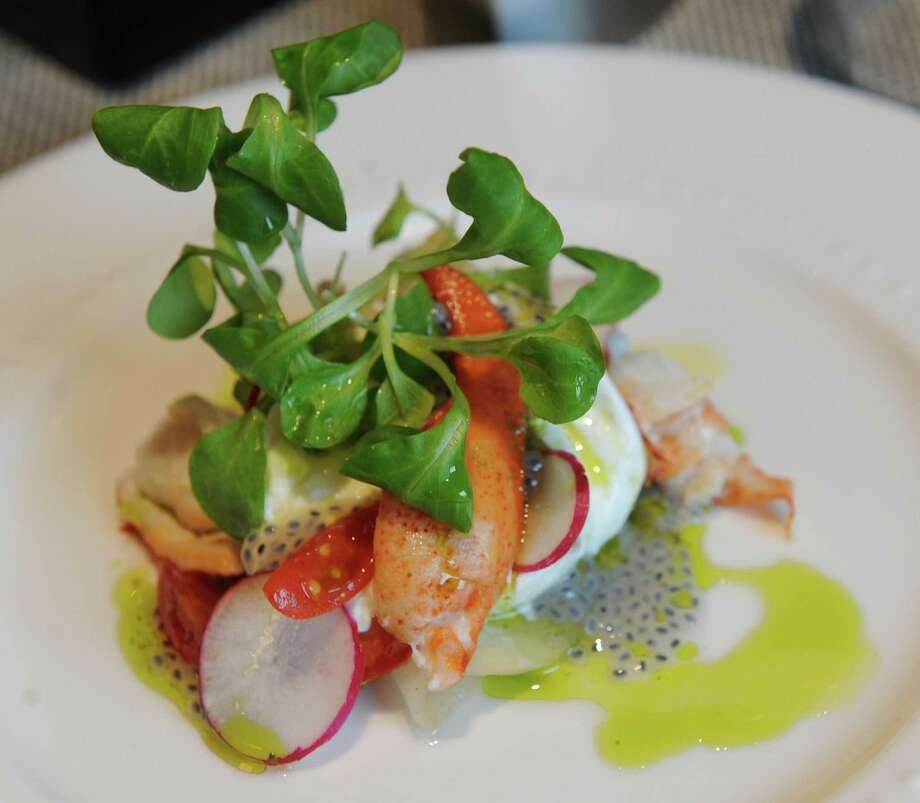 Lobster and burrata, tomato, pickled pear, radish, and basil oil is under starters on the menu at Tala American Bistro on Thursday, June 13, 2013 in Latham, N.Y. (Lori Van Buren / Times Union) Photo: Lori Van Buren / 00022785A