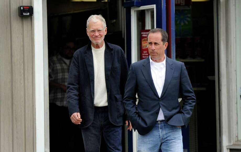 "David Letterman, left, and Jerry Seinfeld cross Railroad Street after paying a visit to Taylor & Son True Value store. The two were in New Milford to do a spot for Seinfeld's show ""Comedians In Cars Getting Coffee,"" Friday, April 19, 2013. Photo: Carol Kaliff / The News-Times"
