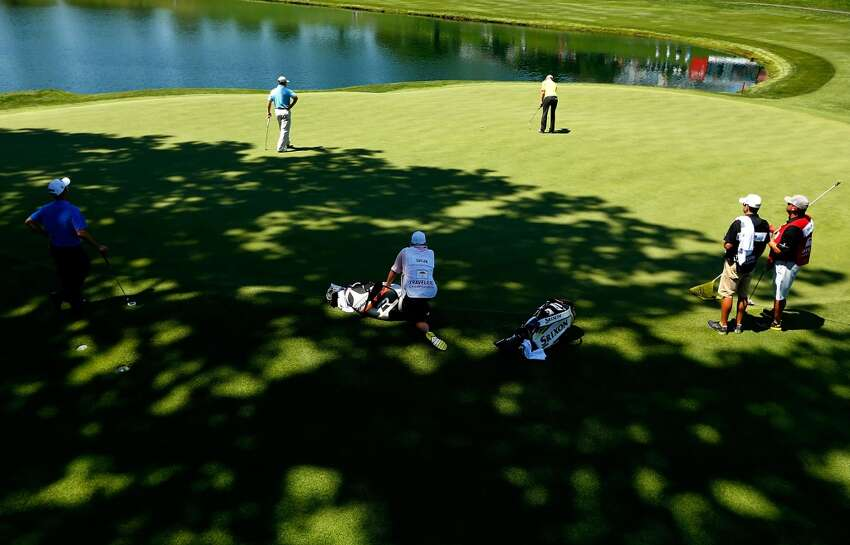 CROMWELL, CT- JUNE 20: Vaughn Taylor putts his ball on the 18th green in front of John Rollins and Robert Streb during the first round of the 2013 Travelers Championship at TPC River Highlands on June 20, 2012 in Cromwell, Connecticut. (Photo by Jared Wickerham/Getty Images)