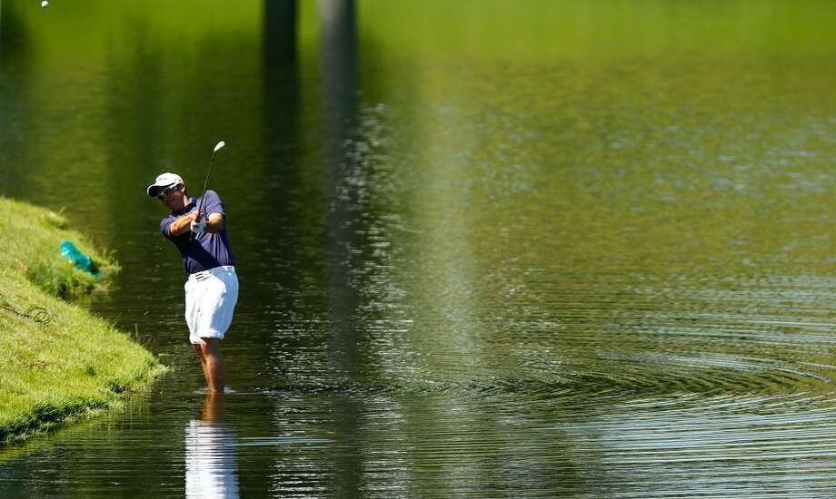 CROMWELL, CT- JUNE 20: Kyle Bilodeau hits his ball from the rough while standing in the water on the 15th hole during the first round of the 2013 Travelers Championship at TPC River Highlands on June 20, 2012 in Cromwell, Connecticut.  (Photo by Jared Wickerham/Getty Images)