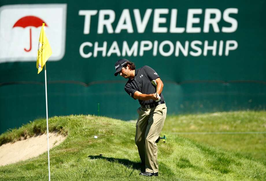 CROMWELL, CT- JUNE 20: Martin Flores hits his ball out of the rough near the 15th green during the first round of the 2013 Travelers Championship at TPC River Highlands on June 20, 2012 in Cromwell, Connecticut.  (Photo by Jared Wickerham/Getty Images)