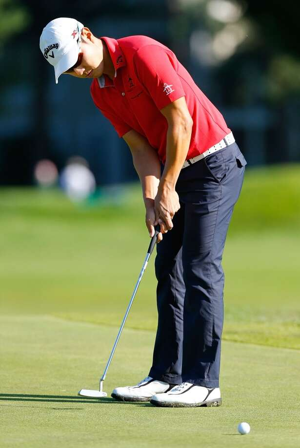 CROMWELL, CT- JUNE 20: Sang-Moon Bae of South Korea putts the ball during the first round of the 2013 Travelers Championship at TPC River Highlands on June 20, 2012 in Cromwell, Connecticut.  (Photo by Jared Wickerham/Getty Images)