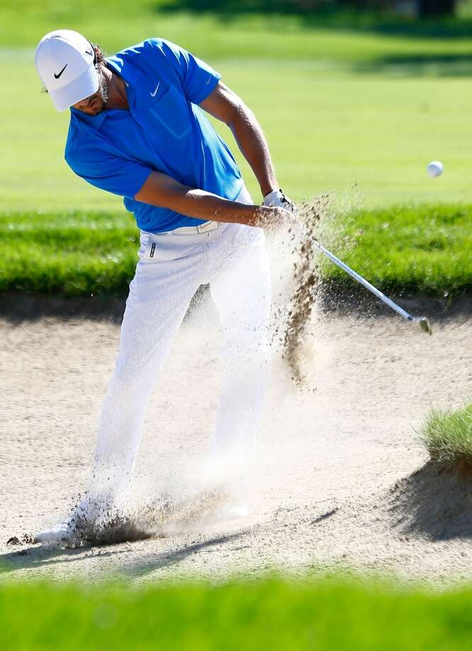 CROMWELL, CT- JUNE 20: Kyle Stanley hits his ball out of the sand trap during the first round of the 2013 Travelers Championship at TPC River Highlands on June 20, 2012 in Cromwell, Connecticut.  (Photo by Jared Wickerham/Getty Images)