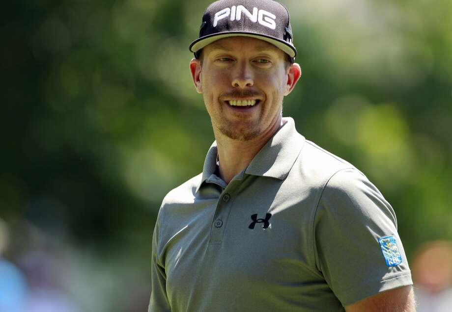 CROMWELL, CT - JUNE 20:  Hunter Mahan laughs on the eighth green during the first round of the Travelers Championship held at TPC River Highlands on June 20, 2013 in Cromwell, Connecticut.  (Photo by Michael Cohen/Getty Images)