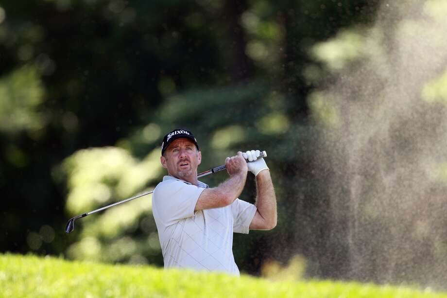 CROMWELL, CT - JUNE 20:  Rod Pampling of Australia hits his second shot on the fourth hole during the first round of the Travelers Championship held at TPC River Highlands on June 20, 2013 in Cromwell, Connecticut.  (Photo by Michael Cohen/Getty Images)