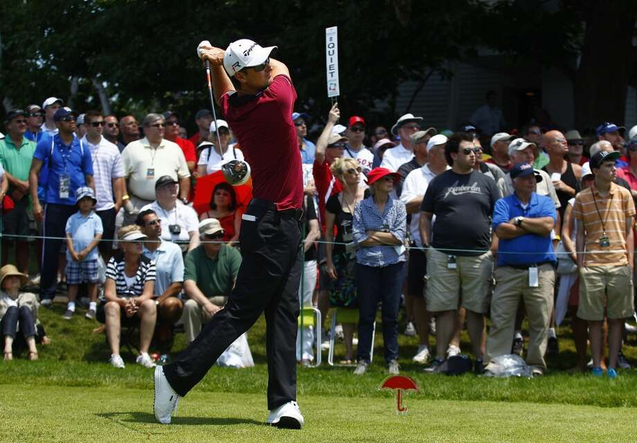 CROMWELL, CT - JUNE 20:  Justin Rose of England hits his drive on the first tee box during the first round of the Travelers Championship held at TPC River Highlands on June 20, 2013 in Cromwell, Connecticut.  (Photo by Michael Cohen/Getty Images)