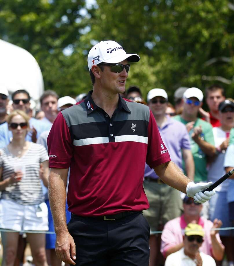 CROMWELL, CT - JUNE 20:  Justin Rose of England acknowledges the gallery on the first tee box during the first round of the Travelers Championship held at TPC River Highlands on June 20, 2013 in Cromwell, Connecticut.  (Photo by Michael Cohen/Getty Images)