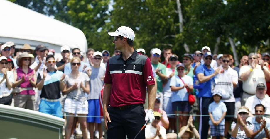 CROMWELL, CT - JUNE 20:  Justin Rose of England is greeted by fans on the first tee box during the first round of the Travelers Championship held at TPC River Highlands on June 20, 2013 in Cromwell, Connecticut.  (Photo by Michael Cohen/Getty Images)
