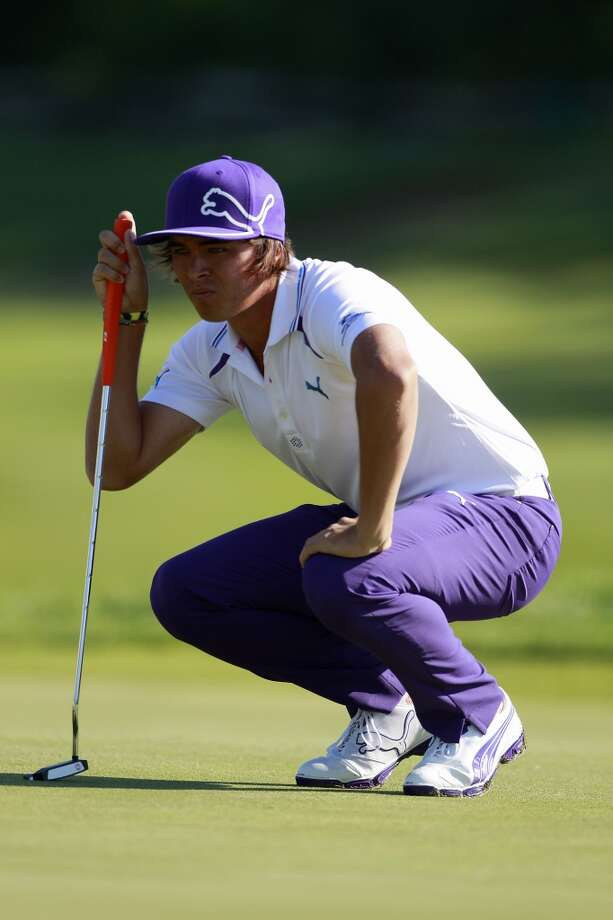 CROMWELL, CT - JUNE 20:  Rickie Fowler lines up a putt on the 12th hole during the first round of the Travelers Championship held at TPC River Highlands on June 20, 2013 in Cromwell, Connecticut.  (Photo by Michael Cohen/Getty Images)