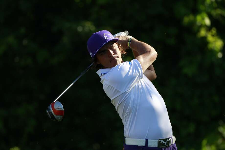 CROMWELL, CT - JUNE 20:  Rickie Fowler hits a drive on the 12th hole during the first round of the Travelers Championship held at TPC River Highlands on June 20, 2013 in Cromwell, Connecticut.  (Photo by Michael Cohen/Getty Images)