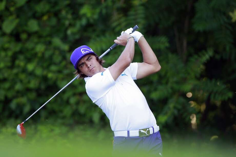 CROMWELL, CT - JUNE 20:  Rickie Fowler hits a drive on the 13th hole during the first round of the Travelers Championship held at TPC River Highlands on June 20, 2013 in Cromwell, Connecticut.  (Photo by Michael Cohen/Getty Images)