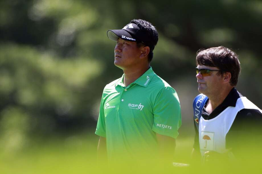 CROMWELL, CT - JUNE 20:  K.J. Choi (L) of South Korea looks on during the first round of the Travelers Championship held at TPC River Highlands on June 20, 2013 in Cromwell, Connecticut.  (Photo by Michael Cohen/Getty Images)