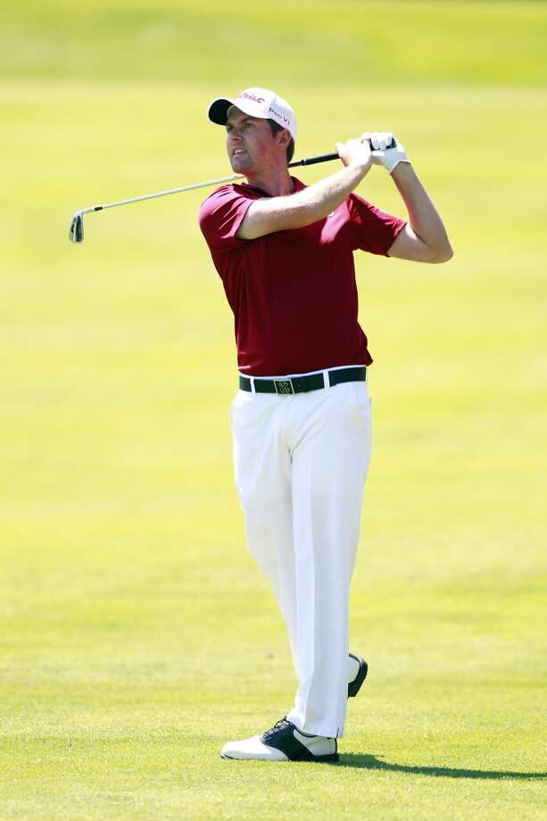 CROMWELL, CT - JUNE 20:  Webb Simpson hits a shot from the fairway during the first round of the Travelers Championship held at TPC River Highlands on June 20, 2013 in Cromwell, Connecticut.  (Photo by Michael Cohen/Getty Images)