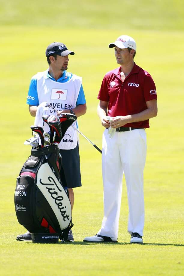 CROMWELL, CT - JUNE 20: Webb Simpson (R) stands by his golf bag during the first round of the Travelers Championship held at TPC River Highlands on June 20, 2013 in Cromwell, Connecticut.  (Photo by Michael Cohen/Getty Images)