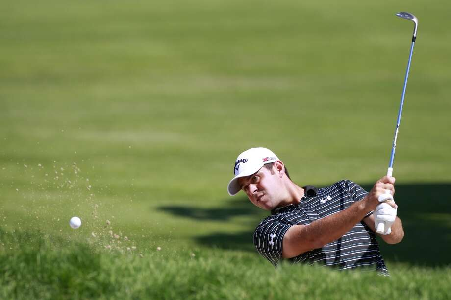 CROMWELL, CT - JUNE 20:  Gary Woodland hits a shot from a bunker during the first round of the Travelers Championship held at TPC River Highlands on June 20, 2013 in Cromwell, Connecticut.  (Photo by Michael Cohen/Getty Images)