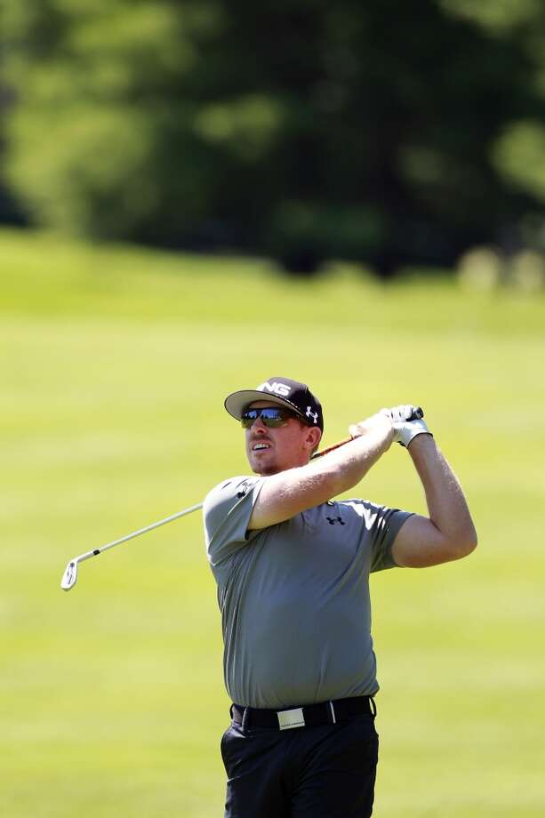 CROMWELL, CT - JUNE 20:  Hunter Mahan hits a shot from the fairway during the first round of the Travelers Championship held at TPC River Highlands on June 20, 2013 in Cromwell, Connecticut.  (Photo by Michael Cohen/Getty Images)