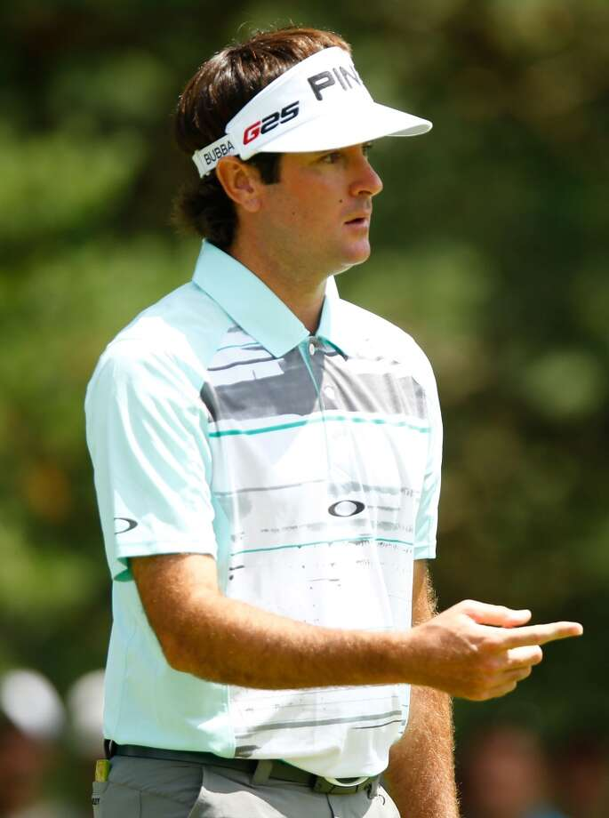 CROMWELL, CT- JUNE 20: Bubba Watson reacts after missing a putt during the first round of the 2013 Travelers Championship at TPC River Highlands on June 20, 2012 in Cromwell, Connecticut.  (Photo by Jared Wickerham/Getty Images)