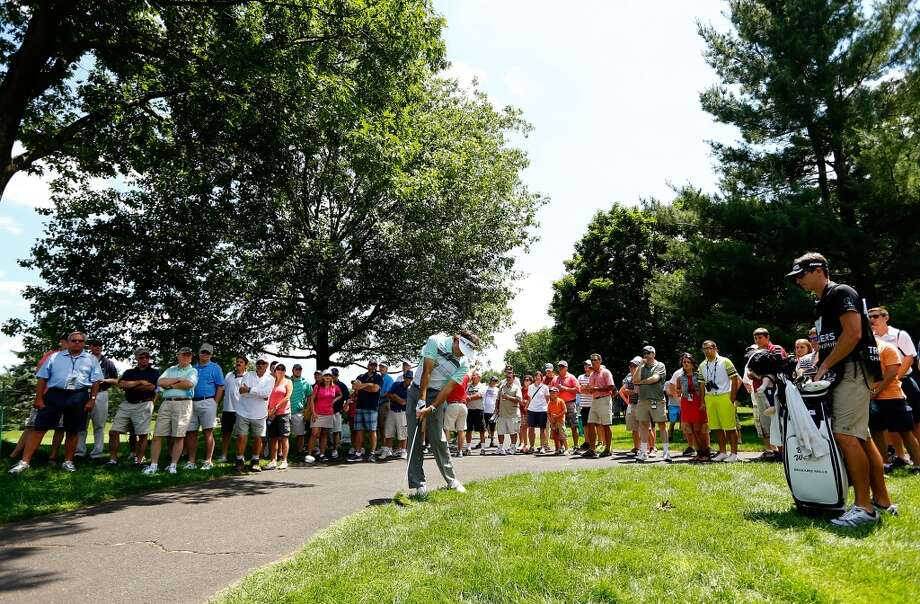 CROMWELL, CT- JUNE 20: Bubba Watson takes his second shot near the cart path during the first round of the 2013 Travelers Championship at TPC River Highlands on June 20, 2012 in Cromwell, Connecticut.  (Photo by Jared Wickerham/Getty Images)