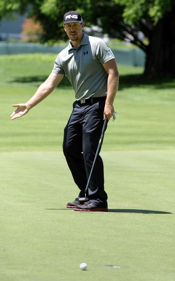 Hunter Mahan reacts to missing a birdie putt on the seventh hole during the first round of the Travelers Championship golf tournament in Cromwell, Conn., Thursday, June 20, 2013.  (AP Photo/Fred Beckham)