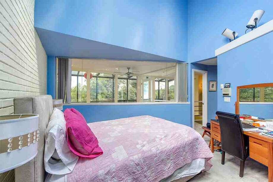 Bedroom of 6318 E. Green Lake Way N. The 4,480-square-foot house, built in 1923 but overhauled in 1984, has five bedrooms, 4.25 bathrooms, a family room, sun rooms, slate floors, vaulted ceilings, a wet bar, a balcony and a roof deck on a 4,401-square-foot lot with a view of Green Lake. It's listed for $1.2 million. Photo: Courtesy Glen Sung, John L. Scott Real Estate