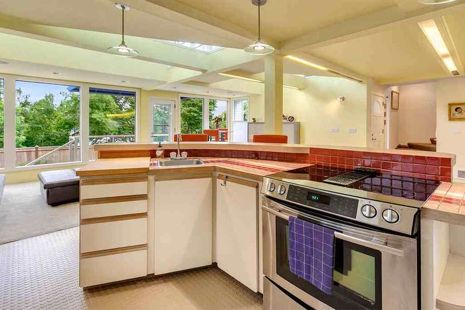 Kitchen of 6318 E. Green Lake Way N. The 4,480-square-foot house, built in 1923 but overhauled in 1984, has five bedrooms, 4.25 bathrooms, a family room, sun rooms, slate floors, vaulted ceilings, a wet bar, a balcony and a roof deck on a 4,401-square-foot lot with a view of Green Lake. It's listed for $1.2 million. Photo: Courtesy Glen Sung, John L. Scott Real Estate