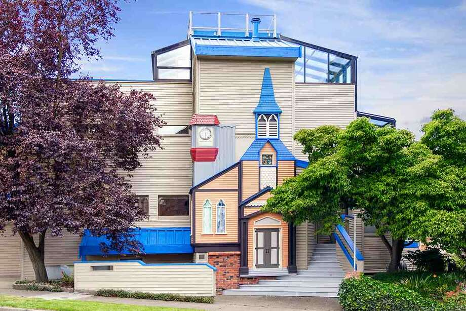 Looking for a big, contemporary home with a touch of whimsy in Green Lake? Check out 6318 E. Green Lake Way N. The 4,480-square-foot house, built in 1923 but overhauled in 1984, has five bedrooms, 4.25 bathrooms, a family room, sun rooms, slate floors, vaulted ceilings, a wet bar, a balcony and a roof deck on a 4,401-square-foot lot with a view of Green Lake. It's listed for $1.2 million. Photo: Courtesy Glen Sung, John L. Scott Real Estate