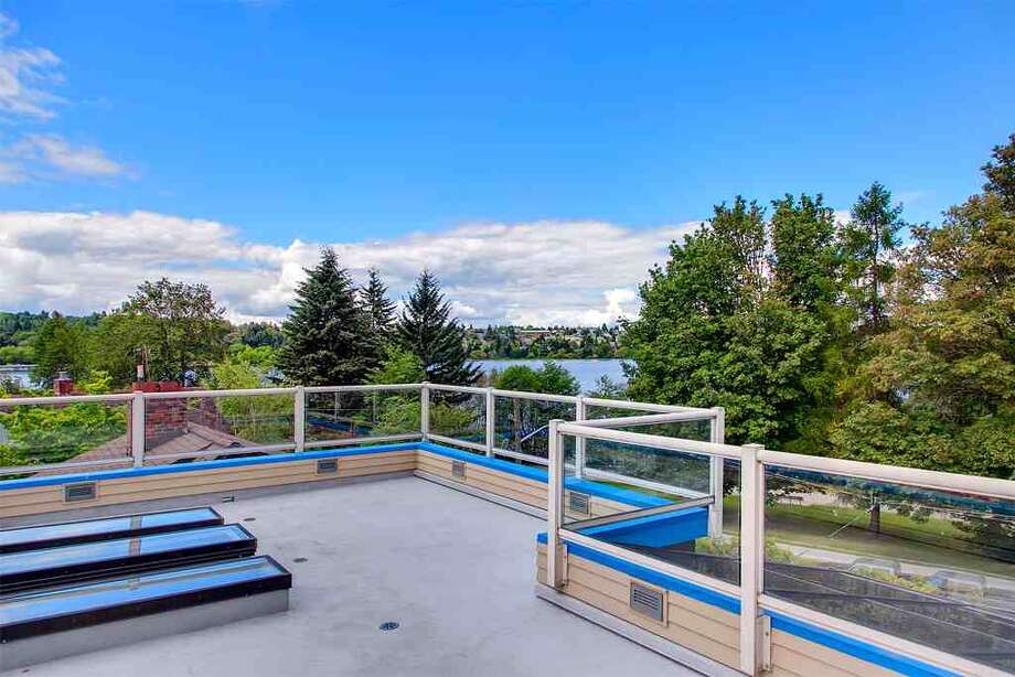 Roof deck of 6318 E. Green Lake Way N. The 4,480-square-foot house, built in 1923 but overhauled in 1984, has five bedrooms, 4.25 bathrooms, a family room, sun rooms, slate floors, vaulted ceilings, a wet bar and a balcony on a 4,401-square-foot lot with a view of Green Lake. It's listed for $1.2 million. Photo: Courtesy Glen Sung, John L. Scott Real Estate