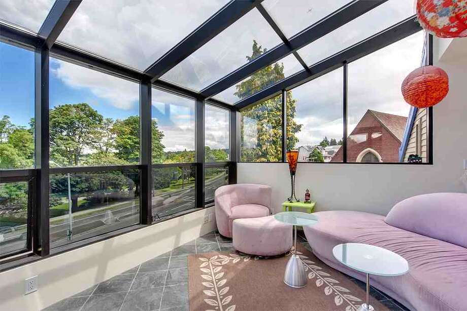 Top floor of 6318 E. Green Lake Way N. The 4,480-square-foot house, built in 1923 but overhauled in 1984, has five bedrooms, 4.25 bathrooms, a family room, sun rooms, slate floors, vaulted ceilings, a wet bar, a balcony and a roof deck on a 4,401-square-foot lot with a view of Green Lake. It's listed for $1.2 million. Photo: Courtesy Glen Sung, John L. Scott Real Estate