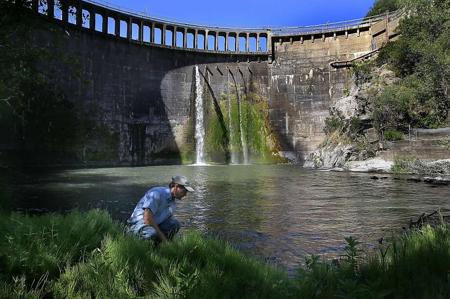 Don Lingenfelter, the dam keeper since 1973, studies the water below the 106-foot San Clemente Dam on the Carmel River. Conservationists hope that its removal will spur other similar removal projects in the state. Photo: Michael Macor, The Chronicle