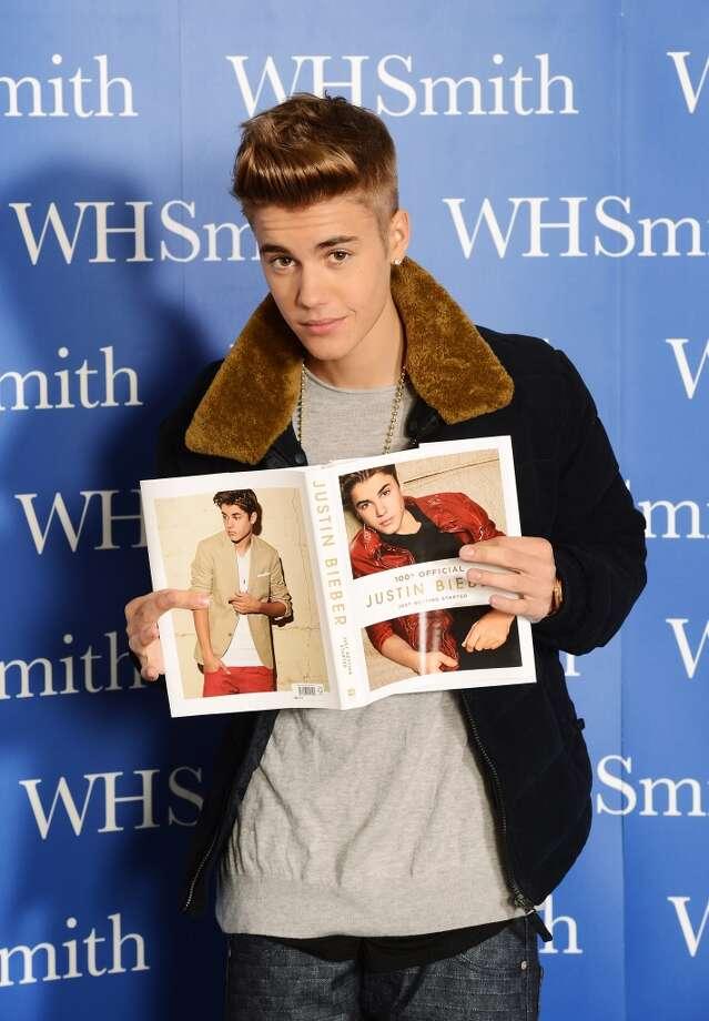 Justin Bieber points at himself.