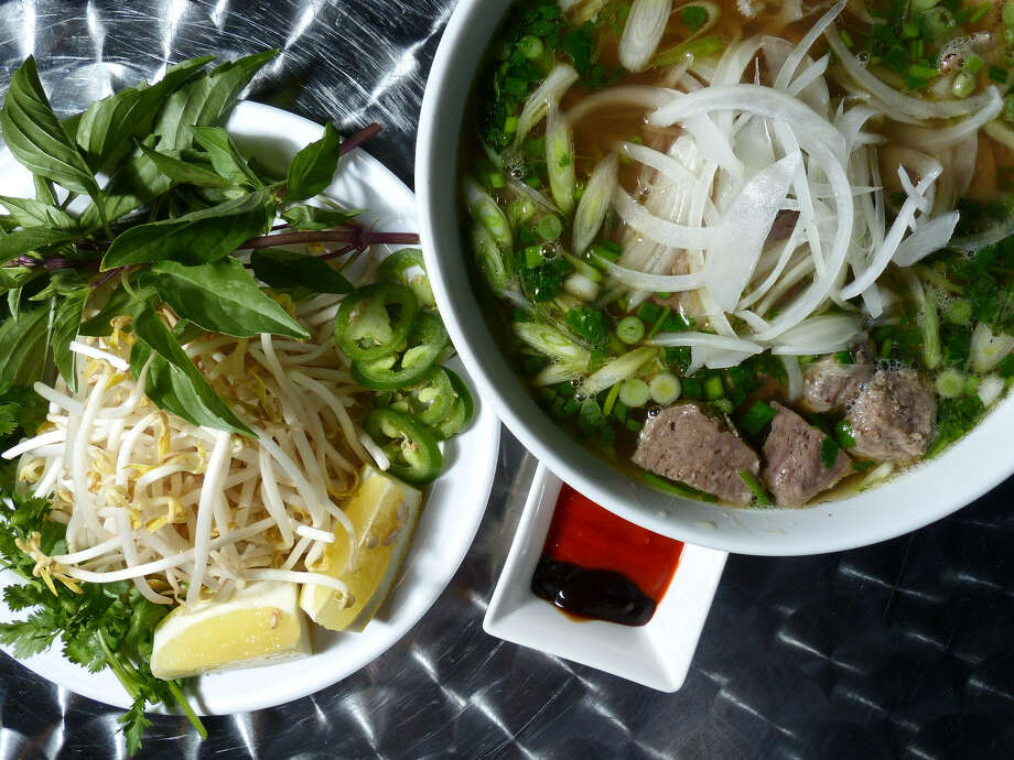 The combination pho includes thin slices of rare fillet mignon, brisket, tendon, tripe and sliced meatball. Photo: Photos By Billy Calzada / San Antonio Express-News