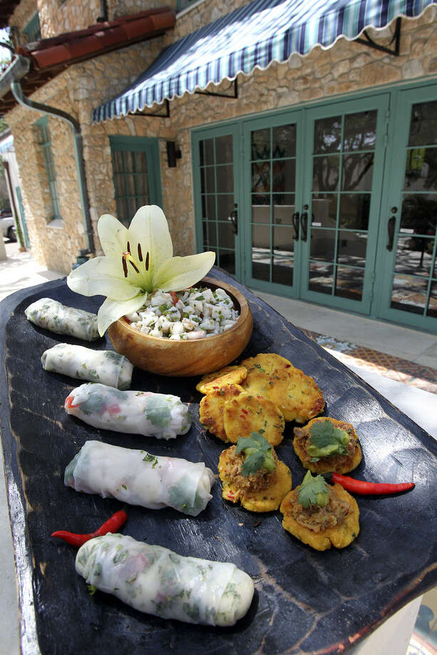 Among offerings from Spice of Life are Ceviche Summer Rolls (left) and White Cheddar Arepas. Photo: Tom Reel / San Antonio Express-News