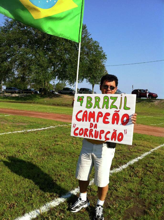 Adauto Calheira joined local residents in Seaside Park in Bridgeport, Conn.on Thursday, June 20, 2013  for a passive protest in support of people speaking out against corruption in their native Brazil. Photo: Keila Torres Ocasio / Connecticut Post