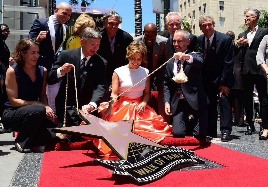 Jennifer Lopez reacts as her star is unveiled in Hollywood, California on June 20, 2013, where she was the recipient of the 2,500th Star along Hollywood's Walk of Fame.  AFP PHOTO/Frederic J. BROWNFREDERIC J. BROWN/AFP/Getty Images