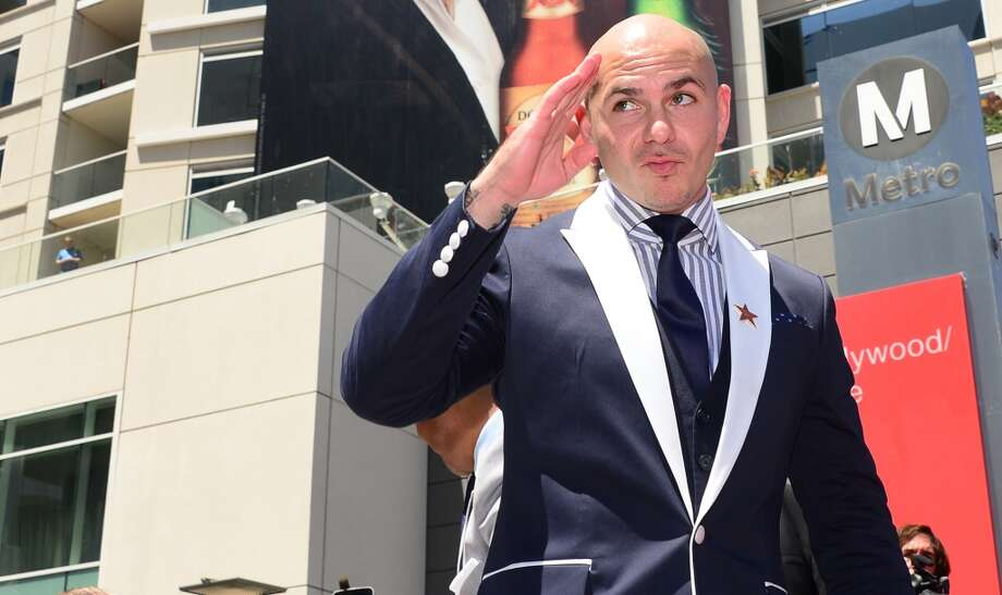 Musician Pitbull gestures at the unveiling of Jennifer Lopez's star in Hollywood, California on June 20, 2013. Lopez is the recipient of the 2,500th Star along Hollywood's Walk of Fame.  AFP PHOTO/Frederic J. BROWN        (Photo credit should read FREDERIC J. BROWN/AFP/Getty Images)