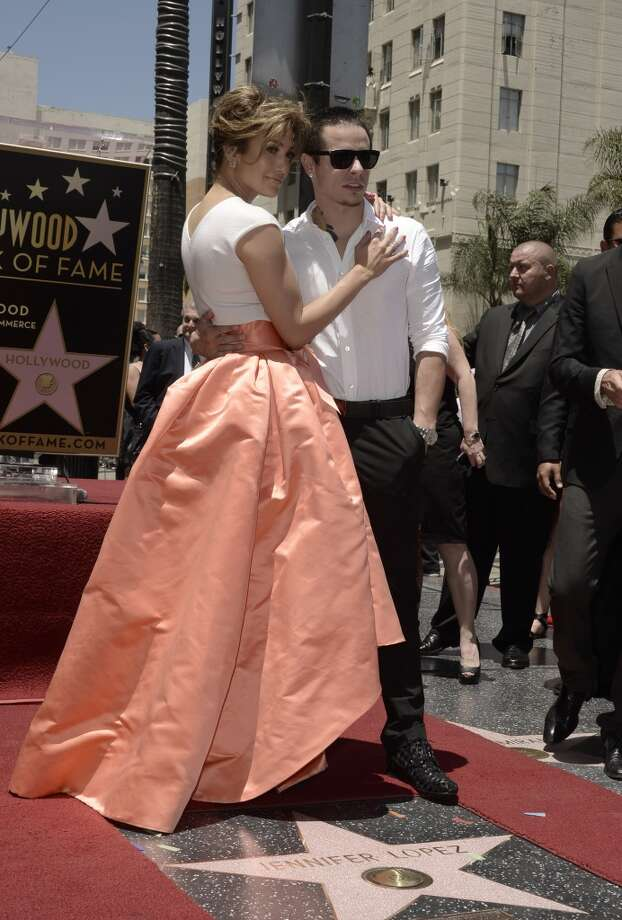 HOLLYWOOD, CA - Jennifer Lopez poses with Casper Smart as she is honored with a star on the Hollywood Walk Of Fame June 20, 2013 in Hollywood, California.  (Photo by Kevin Winter/Getty Images)