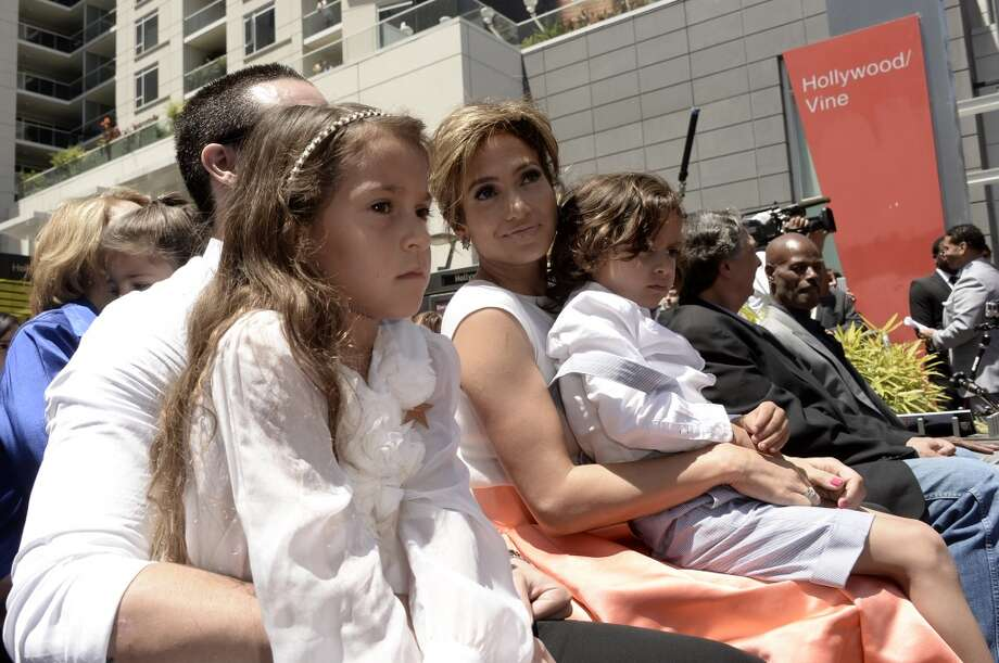 HOLLYWOOD, CA - Jennifer Lopez sits with Casper Smart and her daughter Emme Maribel and son Maximilian David as she is honored with a star on the Hollywood Walk Of Fame June 20, 2013 in Hollywood, California.  (Photo by Kevin Winter/Getty Images)