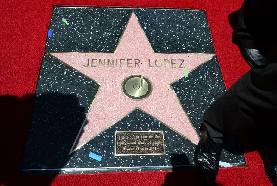 International superstar Jennifer Lopez's unveiled star in Hollywood, California on June 20, 2013. Lopez is the recipient of the 2,500th Star along Hollywood's Walk of Fame.  AFP PHOTO/Frederic J. BROWNFREDERIC J. BROWN/AFP/Getty Images