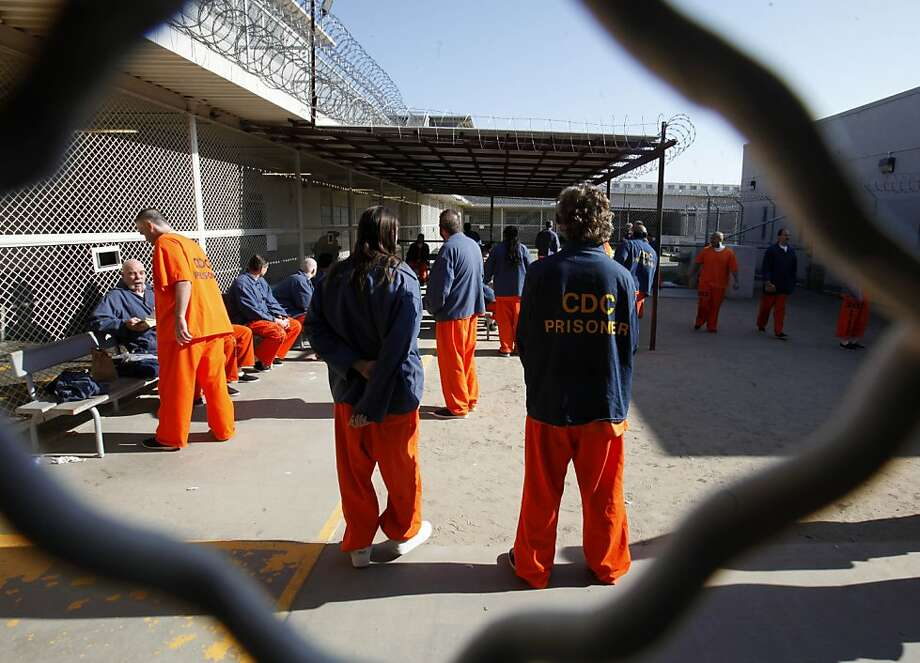 Inmates at Deuel Vocational Institution in Tracy walk around the recreation yard. State prisons are overcrowded, and federal judges want the population reduced by 5,385 more this year. Photo: Rich Pedroncelli, Associated Press