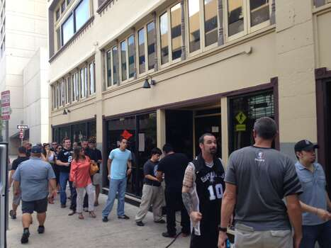 "At 6:30 p.m., an hour and a half before tipoff, there's already a line to get into The Ticket downtown. General manager Lex Moreno, 35, said this kind of crowd rivals just a few other sporting events the downtown sports bar has hosted. ""Wow, you know in our six years of existence there have been some equally monumental ones: UFC 100; Super Bowl 2009, 2010; (Texas) A&M vs. Alabama; and there was Game 6 (of this series)."" Photo: Benjamin Olivo / MySA.com"