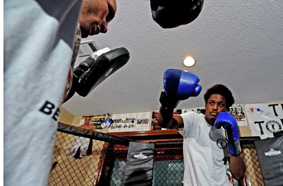 Mixed martial arts fighters Cody Williams, left, and Ryan Spann, right, practice for their fights in Pharr, Texas on Friday, June 21, 2013. Photo taken: Randy Edwards/The Enterprise