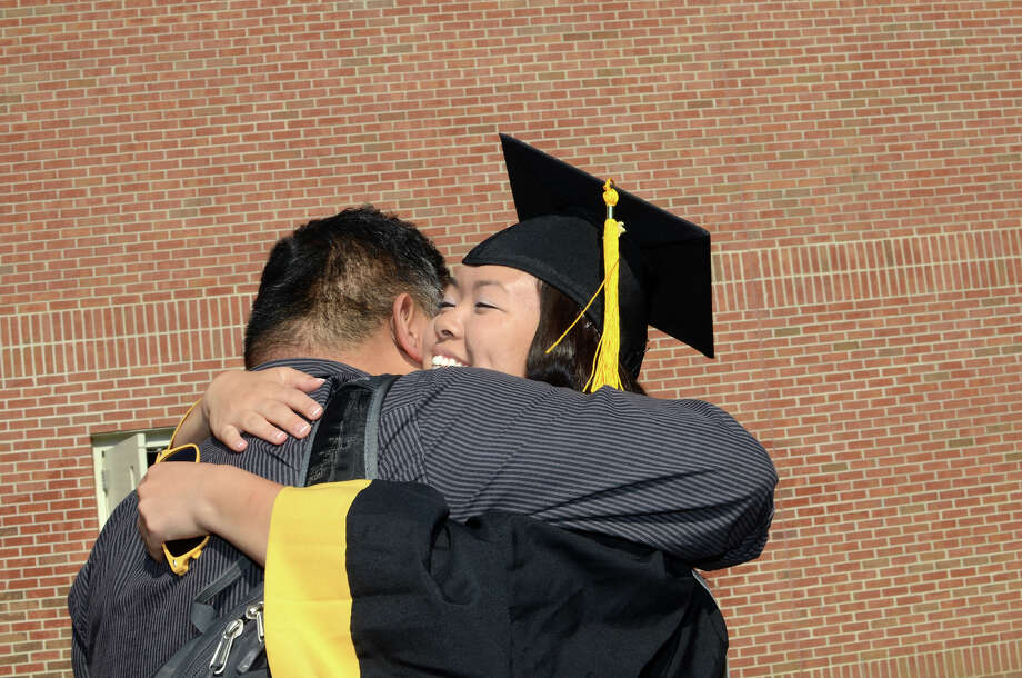 Graduate Tatiana Eng hugs her uncle Ben Ng during the 2013 commencement excercises at Jonathan Law High School in Milford on Thursday, June 20, 2013. Photo: Amy Mortensen / Connecticut Post Freelance