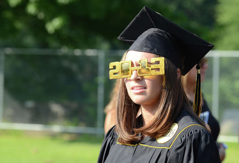 Graduate Catherine Miller sports 2013 glasses as she walks in the graduate procession during the 2013 commencement excercises at Jonathan Law High School in Milford on Thursday, June 20, 2013. Photo: Amy Mortensen / Connecticut Post Freelance