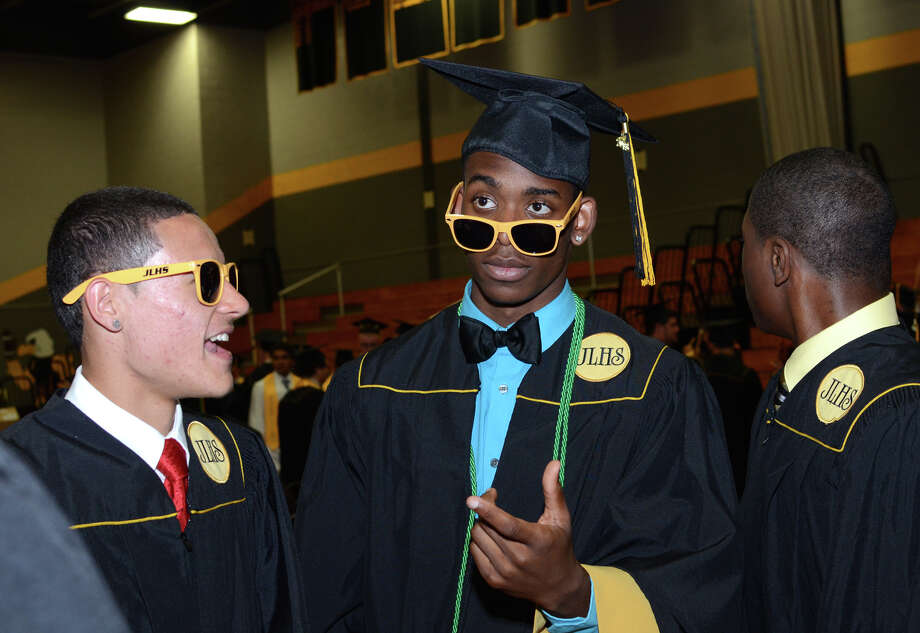 Graduates Ivan Montanez, at left, and Najee Smith, in the staging area during the 2013 commencement excercises at Jonathan Law High School in Milford on Thursday, June 20, 2013. Photo: Amy Mortensen / Connecticut Post Freelance
