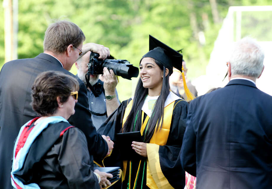 Valedictorian Anisha Manglani receives her diploma during the 2013 commencement excercises at Jonathan Law High School in Milford on Thursday, June 20, 2013. Photo: Amy Mortensen / Connecticut Post Freelance