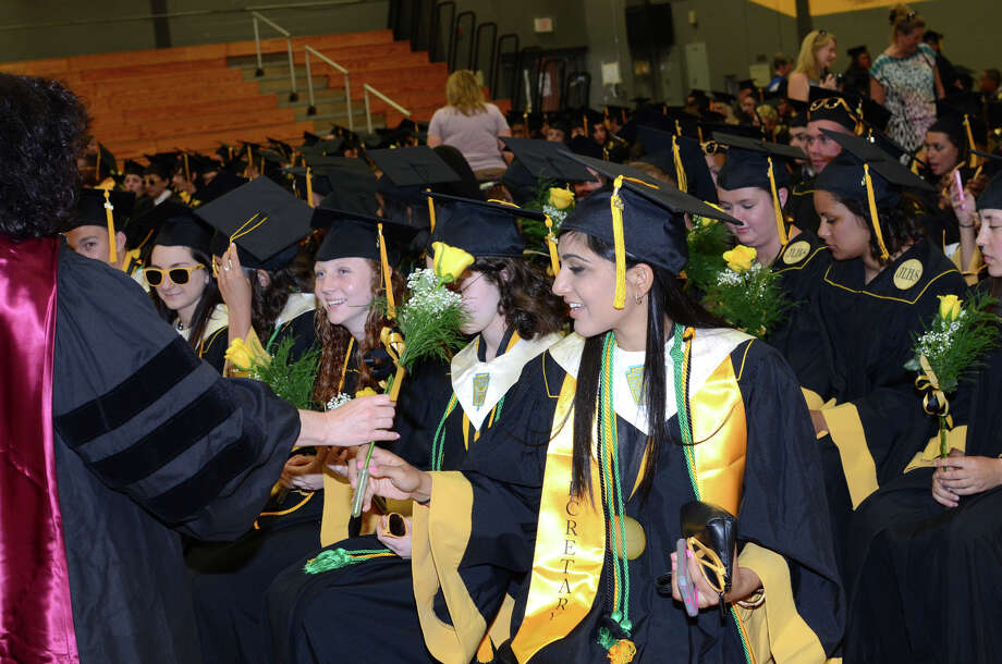 Valedictorian Anisha Manglani, far right, receives a rose in the graduate staging area during the 2013 commencement excercises at Jonathan Law High School in Milford on Thursday, June 20, 2013. Photo: Amy Mortensen / Connecticut Post Freelance