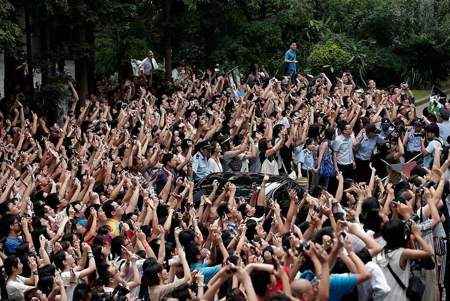 SHANGHAI, CHINA - JUNE 20: David Beckham fans take photos during his visit at Tongji University on June 20, 2013 in Shanghai, China. (Photo by Lintao Zhang/Getty Images) Photo: Lintao Zhang, Getty Images