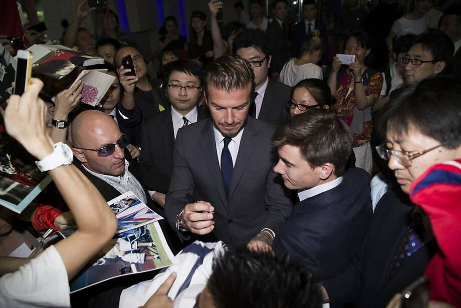 SHANGHAI, CHINA - JUNE 20:  (CHINA OUT) David Beckham signs for fans as he leaves a hotel on June 20, 2013 in Shanghai, China.  (Photo by ChinaFotoPress/ChinaFotoPress via Getty Images) Photo: ChinaFotoPress, Getty Images
